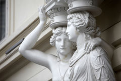 Caryatid. Statues of two young women in Vienna Royalty Free Stock Photos