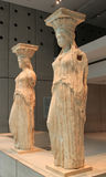 Caryatids female statues. The reamins of Caryatids female statues of the Erechteion temple ruins, at Acropolis Museum, Athens Stock Photo