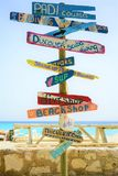 Cas Abao beach, Curacao - March 18, 2019: signposts on the beach. Arrow, background, beach shop, sign, beach sign. wood, beach, signs, blue, business, caribbean royalty free stock photo