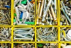 Cas avec de petits objets de construction Placez la réparation de métal ouvré à b photographie stock libre de droits