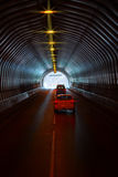 Cas are in long road tunnel Royalty Free Stock Photos