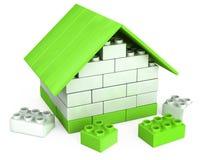 casa 3D de los pedazos plásticos del juego de niños Imagen de archivo