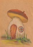 Casa alaranjada fantástica do cogumelo fotografia de stock royalty free