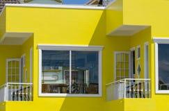 Casa amarilla con los balcones Foto de archivo libre de regalías