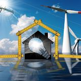 Casa - ampola - painel solar - turbinas eólicas Fotografia de Stock