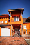 Casa arancione Fotografie Stock