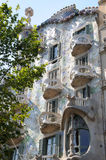 Casa Batllo by Antoni Gaudi. The facade, including a number of small, elegantly curved balconies, glitters in numerous colours. barcelona - spain stock image