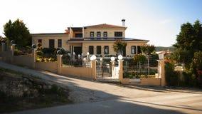 Casa bonita em uma vila Imagens de Stock Royalty Free