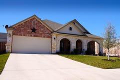 Estrela da construção nova da casa de Texas Imagens de Stock