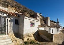 Casa-cavernas das moradias construídas na montagem chinchilla Fotografia de Stock Royalty Free