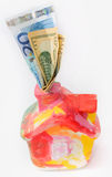 Casa colorida del moneybox con el dólar y el euro Imagen de archivo