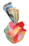 Casa colorida del moneybox con el d?lar y el euro Imagen de archivo libre de regalías