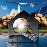 Casa com ampola e recursos renováveis Fotografia de Stock Royalty Free