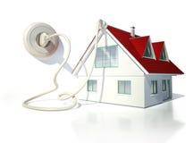 Casa con el cable eléctrico, el enchufe y el zócalo Imagen de archivo libre de regalías