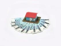 Casa con el dinero Imagenes de archivo