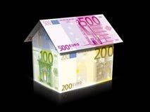 Casa con la energía solar para hacer el dinero Imagen de archivo libre de regalías