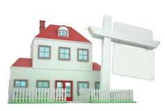 Casa con la muestra en blanco libre illustration