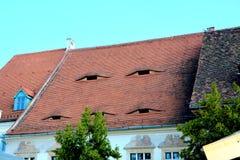 Casa con los ojos en Sibiu, capital europea de la cultura por el año 2007 Foto de archivo libre de regalías