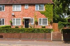 Casa con mattoni a vista rossa Fotografia Stock Libera da Diritti