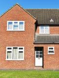 Casa con mattoni a vista rossa Fotografie Stock