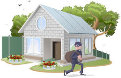 Casa con túnica del ladrón de sexo masculino burglaries Propiedad insurance Fotos de archivo libres de regalías