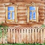 Casa da cabana com as janelas azuis no campo da vila Fotografia de Stock