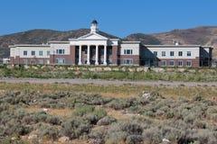 Casa da escola nas varas Imagem de Stock