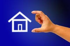 Casa da mão e do ícone Imagem de Stock