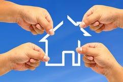Casa da mão e do ícone Imagens de Stock