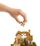 Casa da mão e do enigma Foto de Stock Royalty Free
