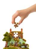 Casa da mão e do enigma Foto de Stock
