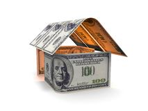 A casa das cédulas em um fundo branco 3d rende Imagem de Stock Royalty Free