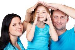 Casa das mãos da família Imagens de Stock