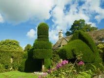 Casa de campo e jardins Fotografia de Stock Royalty Free