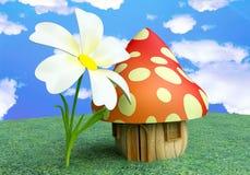 Casa de campo feericamente do cogumelo com flor Fotografia de Stock