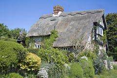 Casa de campo Thatched imagens de stock
