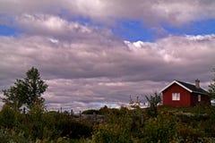 Casa de campo vermelha Fotografia de Stock