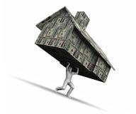 Casa de elevación del hombre hecha del dinero Fotos de archivo