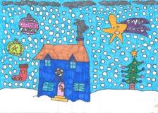 Casa de la Navidad hecha a mano en un fondo azul foto de archivo libre de regalías