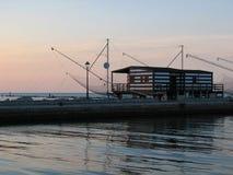 Casa de la pesca en la puesta del sol Foto de archivo libre de regalías
