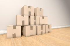 Casa de la pila de la caja de cartón Fotos de archivo