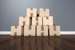 Casa de la pila de la caja de cartón Imágenes de archivo libres de regalías