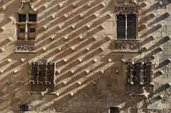 Casa de las Conchas, Salamanca. The walls of the Casa de las Conchas in Salamanca, Spain, are adorned with the shape of carved shells, the emblem of the Santiago Royalty Free Stock Image