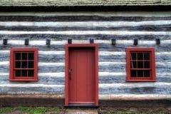 Casa de log colonial Imagem de Stock
