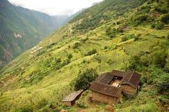 Casa de los residentes locales en la montaña de la nieve de Haba Imagenes de archivo