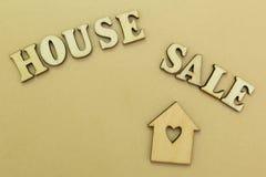 Casa de madeira e a inscri??o imagem de stock royalty free