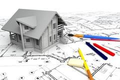 Casa de madeira nos desenhos com artigos de papelaria Fotografia de Stock Royalty Free