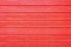 Casa de madeira sintética vermelha da parede da textura Fotografia de Stock Royalty Free