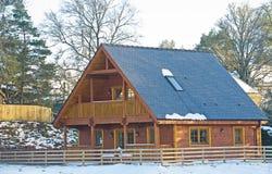 Casa de madera con el balcón Fotos de archivo