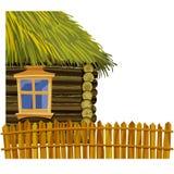 Casa de madera con el tejado cubierto con paja y cerca de madera stock de ilustración
